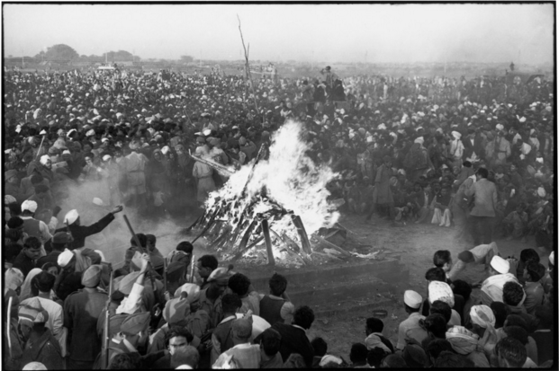 Photo of the cremation of GANDHI on the banks of the Sumna River, Delhi, India by Cartier-Bresson